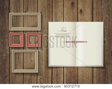 Open square format brochure on a wooden texture. Frame template.