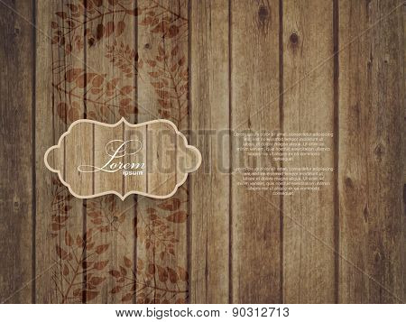 Invitation Card on wooden background with leaves