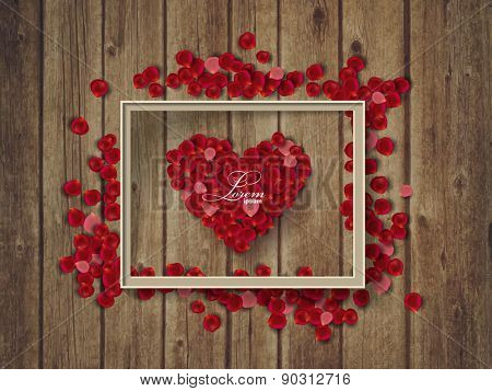 rose petals on wooden texture and frame with heart. Valentine's day concept