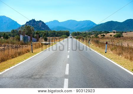 Highway Road With Mountains On Horizon