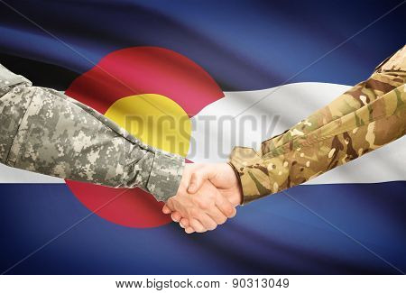 Military Handshake And Us State Flag - Colorado