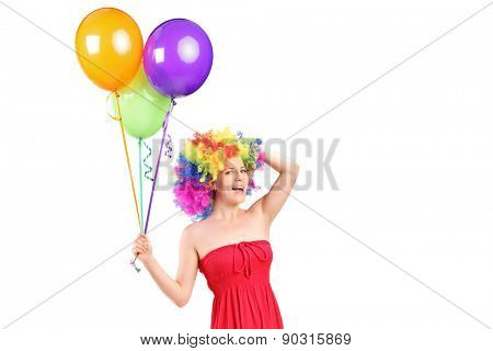 Silly woman with wig holding balloons isolated on white background