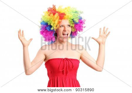 Woman wearing a wig and gesturing with hands isolated on white background