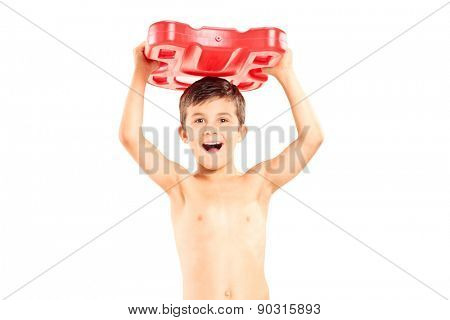 Overjoyed boy holding a swimming float isolated on white background