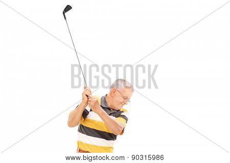 Profile shot of a senior playing golf isolated on white background