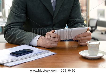 Businessman Using The Tablet Ps At Office