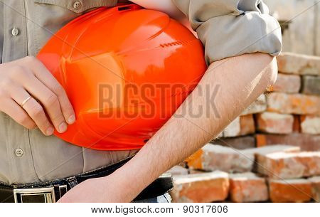 Man Holds A Protective Construction Helmet In Hand