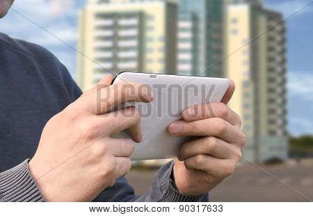 Man Using Tablet Pc Computer Outdoor On A City Street