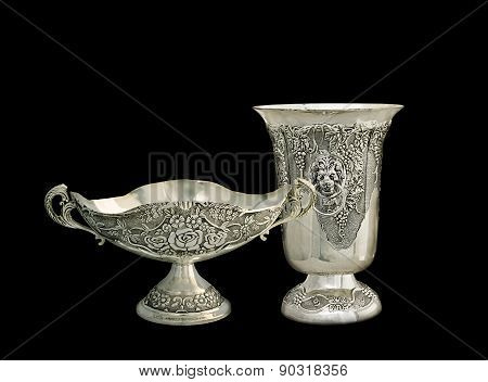 Two Vases From Silver On A Black Background