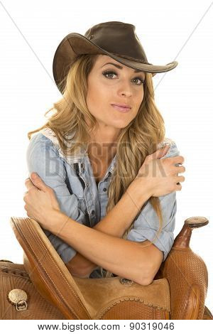 Cowgirl Leaning On Saddle With Arms Crossed