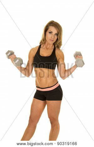 Fit Woman In Black Shorts And Top Curl Two Weights Looking