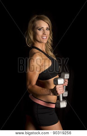 Fit Woman In Black Shorts And Top Side On Black Weights By Stomach