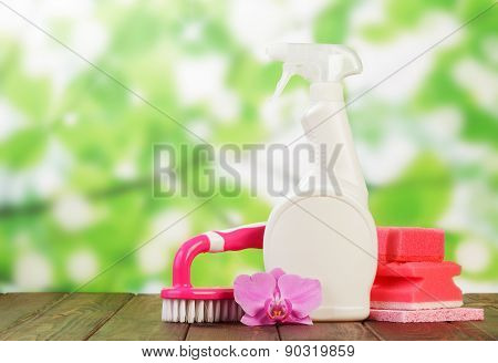 Cleaning products and pink flower