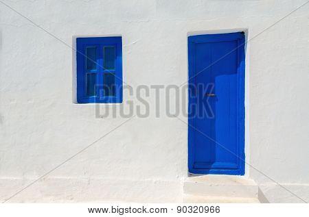 Iconic blue wooden door and window, Greece