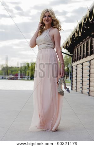 Blond Woman In Evening Gown At Lake