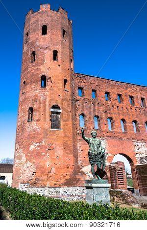 The statue of Ottaviano Augusto and the Torri Palatine,Turin