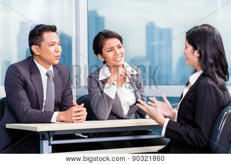 Asian recruitment team hiring candidate in job interview