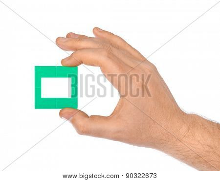 Photo frame for slide in hand isolated on white background
