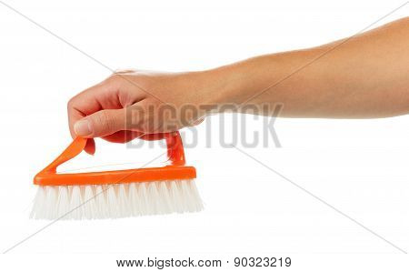 Hand with cleaning brush