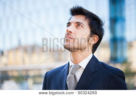 handsome businessman walking in an urban street