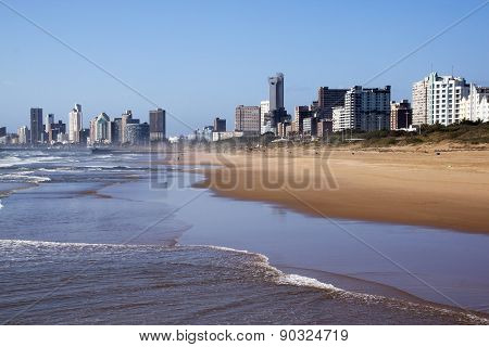 Outgoing Tide Against Durban City Skyline