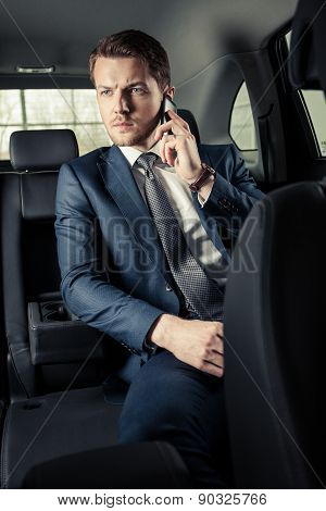 elegant brutal business man in the car