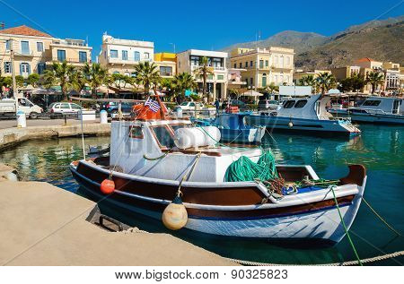 Colorful wooden boats in cosy Greek port