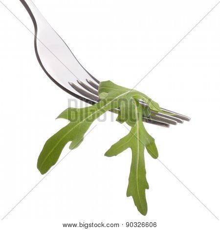 Fresh rucola  salad on fork isolated on white background cutout. Healthy eating concept.