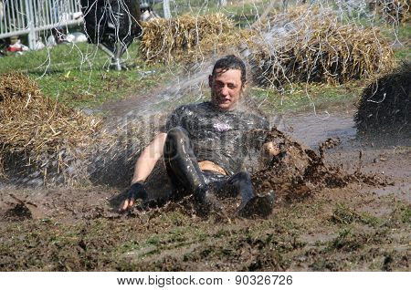 Man Falling In The Mud Squirted With Water