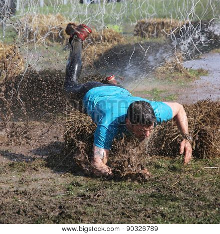Man In Blue Tshirt Makes A Spectacular Overturn In The Mud
