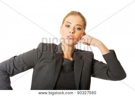 Beautiful woman making phone gesture