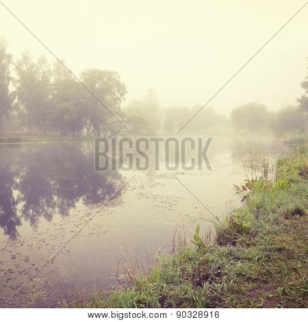 Autumn Landscape with River in Morning Fog