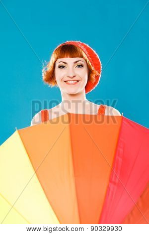 French woman wearing beret. blue background. bright