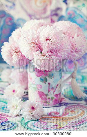 flowers in a beautiful mug