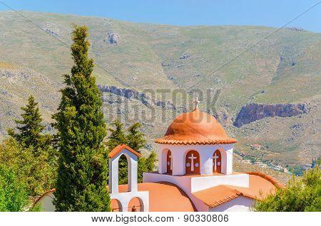 Greek church in mountains with cyprus garden