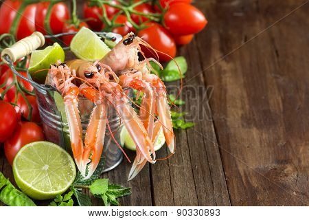 Raw Langoustine In A Bucket With Vegetables