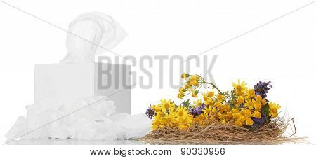 Box with facial wipes and yellow flowers