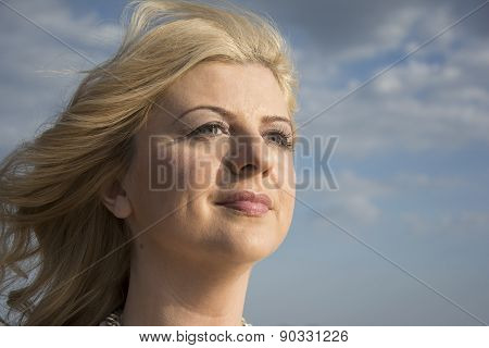 Close Up Portrait Of A Woman While Wind Blowing