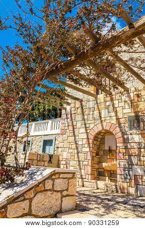 Pergola in front on typial Greek balcony, Greece