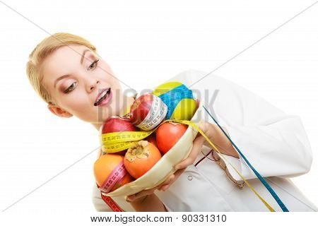 Woman Holding Fruits Dietitian Recommending Healthy Food.