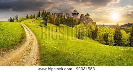 Path To Fortress Ruins On Hillside With Forest At Sunset