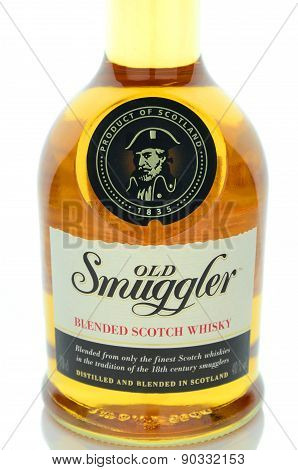 Old smuggler whisky isolated on white background.