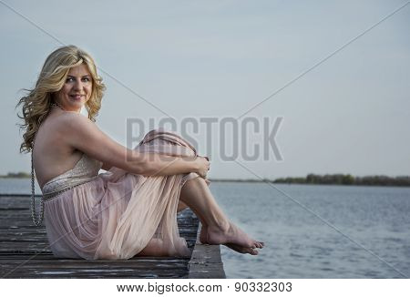Blond Woman In Evening Gown Posing