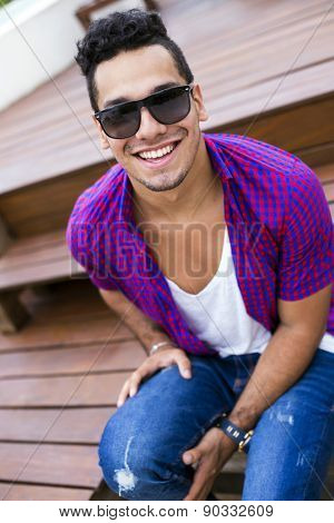 Handsome young man with hipster style