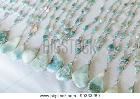 Beads Of Blue Larimar Stone Lie On The Counter