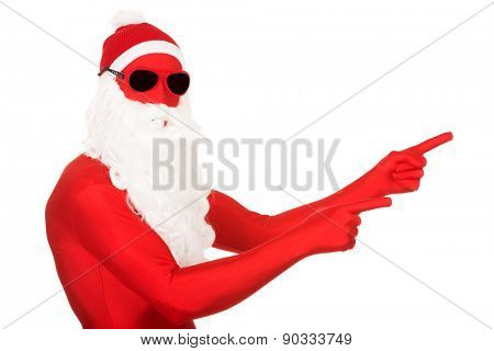 Portrait of santa man in latex clothing pointing.