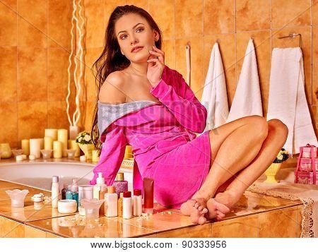 Woman relaxing at home luxury bath. Pink bathrobe.