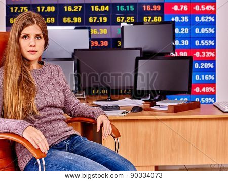 Woman with  stock exchange board play forex in office.
