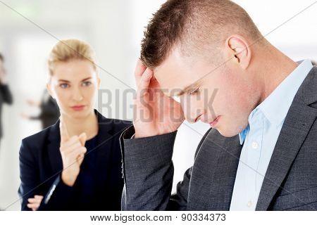 Businesswoman remprimended her business partner.