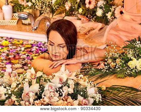 Woman relaxing at water spa. She laid her head on his hands.